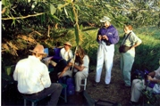 A group of people watching bird banding